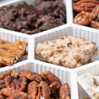 multiple nut house pecan candies in a sampler tin