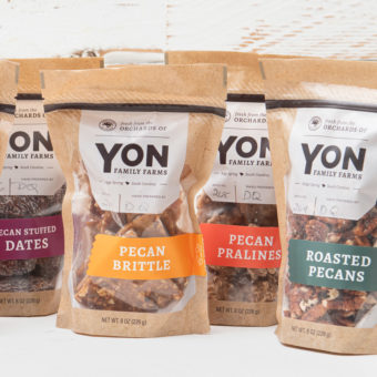 pecan stuffed dates, brittle, prailines and roasted pecans shown in packaging