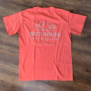 back of pink shirt with nut house logo