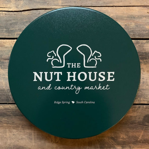 dark green tin with cream Nut House and Country market logo