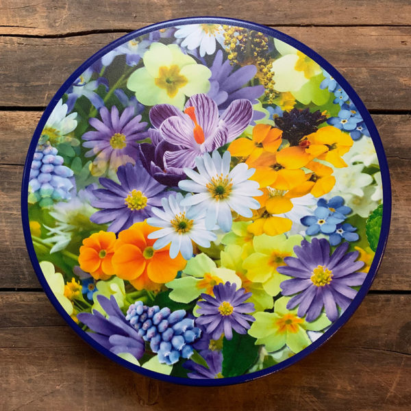 Tin with blue, purple, yellow and white flowers