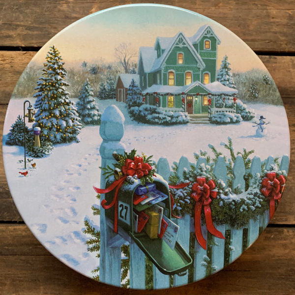 Tin with image of snowy scene with a festively decorated mailbox in foreground