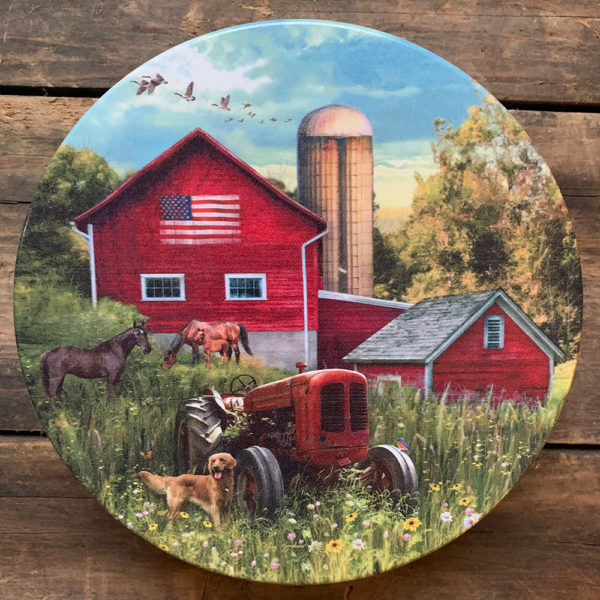 Tin with image of tractor in field with red barn behind