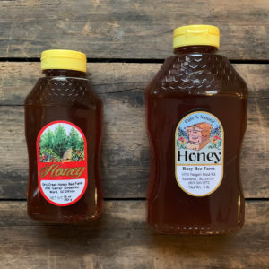 a 16 ounce bottle of honey and a 32 ounce bottle of honey