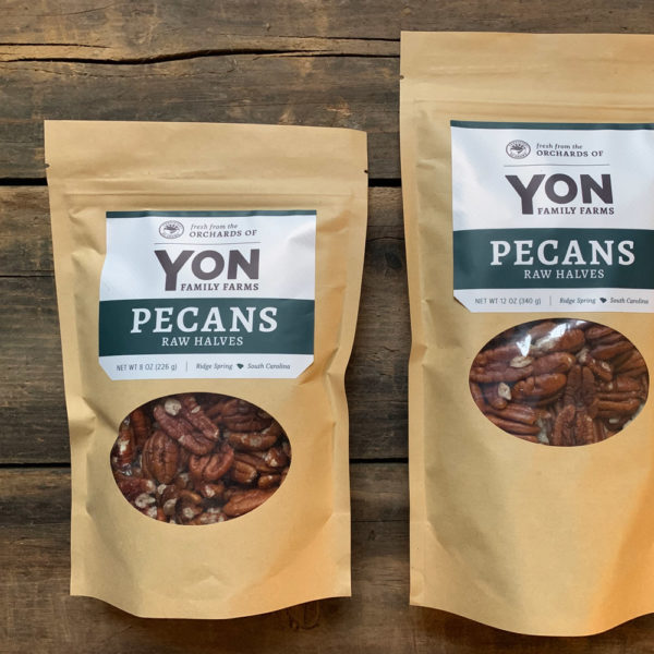 2 kraft bags of Yon Family Farms Raw Pecan Halves