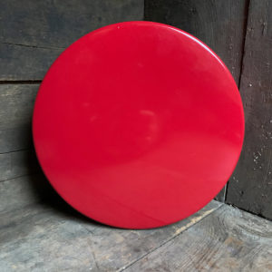 small matte red tin