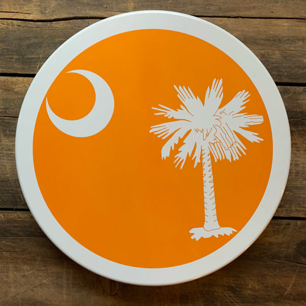 large orange South Carolina Flag design on tin