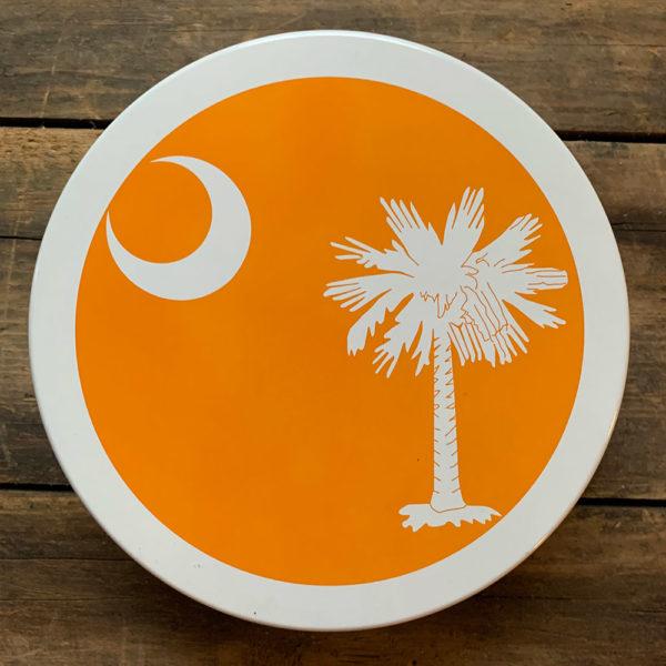 small orange South Carolina Flag design on tin