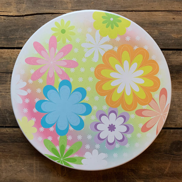 white tin with multi colored whimsical flowers